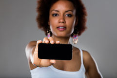 Afroamerican woman showing mobile phone Stock Photography