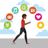Afroamerican woman walking with mobile in hands and social media icons Stock Photography