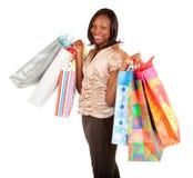 Afroamerikaner-Frau auf einem Einkaufen-Gelage Stockbilder