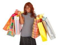 Afroamerikaner-Frau auf einem Einkaufen-Gelage Lizenzfreie Stockfotos