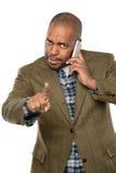 Afroamerikaner-Geschäftsmann Using Cellphone stockfotos