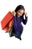Afroamerikanerfrau mit Einkaufenbeuteln Lizenzfreie Stockbilder