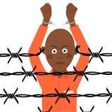 Afroamerikanergefangener in den defekten Handschellen steht über Stacheldraht vektor abbildung