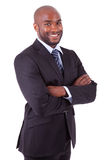 AfroamerikanerGeschäftsmann mit den gefalteten Armen stockfotografie