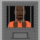 Afroamerikanermann, der von hinter Gittern schaut Lizenzfreies Stockbild