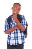 Afroamerikanerschuljunge, der oben - schwarze Menschen schaut Lizenzfreies Stockbild
