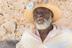Afrocuban man smoking a cigar in Old Havana Royalty Free Stock Image