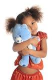 Afroe-amerikanisch asiatische Kinder mit seinem Teddybären Stockbild