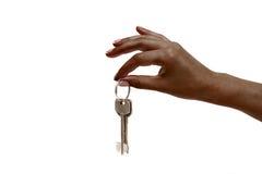 Afrykańska żeńska ręka trzyma klucze na białym tle Obraz Royalty Free