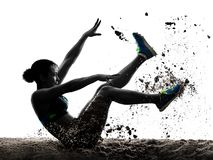 Afrykańska atlet atletyka skok w dal kobieta odizolowywał białego backgro obraz stock