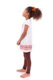 Afrykańska Azjatycka dziewczyna patrzeje coś Zdjęcia Stock