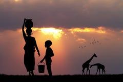 Afrykańska kobieta i dziecko przy zmierzchem royalty ilustracja
