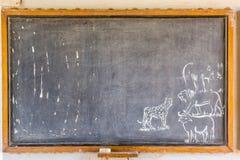 Afrykański blackboard z rysunkami zwierzęta Zdjęcia Stock