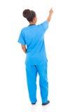 Afrykański pielęgniarki wskazywać Obraz Stock