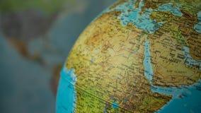 Afryka i środkowa wschodnia mapa na kuli ziemskiej z ziemską mapą w tle Obraz Stock