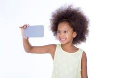 Afrykańska dziewczyna bierze selfie Obraz Royalty Free