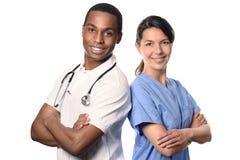 Afrykanin lekarka z uśmiechniętą pielęgniarką Obraz Stock