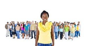 Afrykańskie kobiety Stoi przed różnorodność tłumu pojęciem Obraz Stock