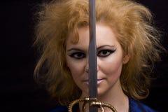 Afschuwelijke heks met zwaard royalty-vrije stock afbeeldingen