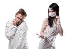 Afschuwverpleegster en zieke patiënt Royalty-vrije Stock Foto's