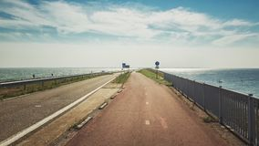 The Afsluitdijk is the thirty-two kilometer long connection  between the Dutch provinces of North Holland and Friesland. The Afsluitdijk is the thirty-two Stock Photography