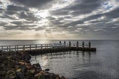 Afsluitdijk z Jetty i wschodem słońca Obrazy Royalty Free
