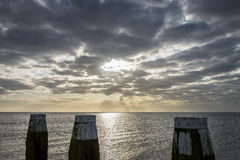 Afsluitdijk z Jetty wschodem słońca i słupami Obrazy Royalty Free