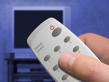 Afstandsbediening ter beschikking en Televisie Royalty-vrije Stock Foto