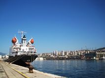 Aft of cargo ship. Aft of black,huge cargo ship in port of city Rijeka at hot,sunny summer day Stock Photo