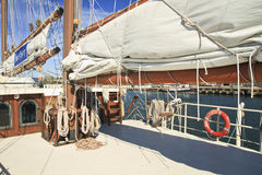 Aft Deck and Aft Boom. Aft deck and sail furled on a tall ship Stock Photo