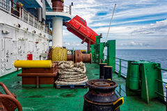 Aft deck of cargo ship. With freefall emergency escape orange lifeboat Stock Image