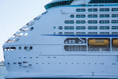 Aft Decks of Luxury Cruise Ship. Huge, white, luxury cruise ship anchored in blue water Stock Photography