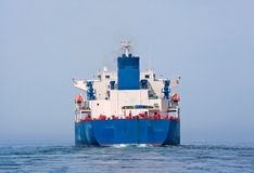 Aft of tanker sailing in the sea. With water splashes from engine Stock Image
