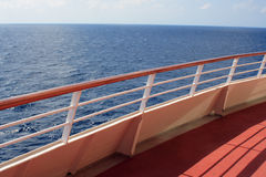 Aft View. View of the ocean over the railing from the deck of a luxury cruise ship Royalty Free Stock Photo