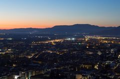 Afterglow with Cityscape and Mountains at Mirador del Barranco del Abogado Lookout in Granada, Spain.  royalty free stock photography