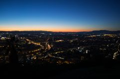 Afterglow with Cityscape and Mountains at Mirador del Barranco del Abogado Lookout in Granada, Spain.  stock photos
