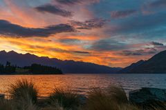 Afterglow after sunset with red sky over lake wakatipu, queenstown, new zealand 1. Afterglow after sunset with red sky over lake wakatipu, queenstown, otago, new stock photo