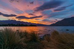 Afterglow after sunset with red sky over lake wakatipu, queenstown, new zealand 3. Afterglow after sunset with red sky over lake wakatipu, queenstown, otago, new royalty free stock images