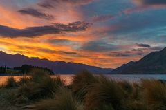 Afterglow after sunset with red sky over lake wakatipu, queenstown, new zealand 2. Afterglow after sunset with red sky over lake wakatipu, queenstown, otago, new stock photography