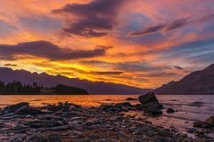 Afterglow after sunset with red sky over lake wakatipu, queenstown, new zealand 5. Afterglow after sunset with red sky over lake wakatipu, queenstown, otago, new stock photo