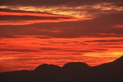 Afterglow of the sunset. And silhouette of the mountains royalty free stock photos
