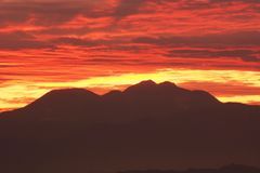 Afterglow of the sunset. And silhouette of the mountains stock image