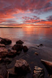 Afterglow. Vibrant colors fill the sky a few minutes after sunset at Lake Oulujarvi, Finland Royalty Free Stock Images