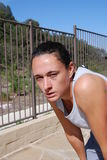 Aftermath of a 30 minute run. Woman exhausted from a 30 min run up hill and down hill  trail Stock Images