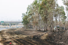 Aftermath of the Epping Bushfires. EPPING, AUSTRALIA - 20 DECEMBER 2015: A day after fires swept through Epping in Melbourne, CFA Fire Crews patrol the area for Royalty Free Stock Image