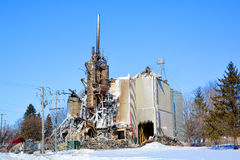 Aftermath fire destroys mill. ANGE-GARDIEN QUEBEC CANADA FEV 28: Aftermath fire destroys mill, Firefighters evacuated 15 homes because of the intensity of the Royalty Free Stock Image