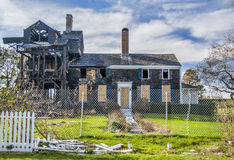 The Aftermath. A historical old farmhouse is ravaged and destroyed by fire Royalty Free Stock Photography