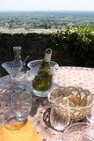 Aftermath of outdoor lunch in Southern France. Aftermath of lunch, table overlooking vineyards Stock Image