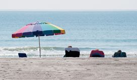 Afternoon at the Beach. Beach chairs and an umbrella make for a sunny afternoon at the beach Royalty Free Stock Image