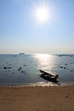 Afternoon on the beach with small boat in Thailand Stock Photos
